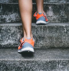 Legs and feet climbing up stairs, Exercise, and activity are important for your mental health!