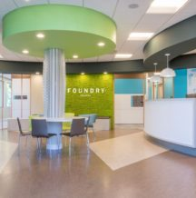 Inside the front doors of foundry Kelowna, a lovely and calming office with baby blue and light green colouring