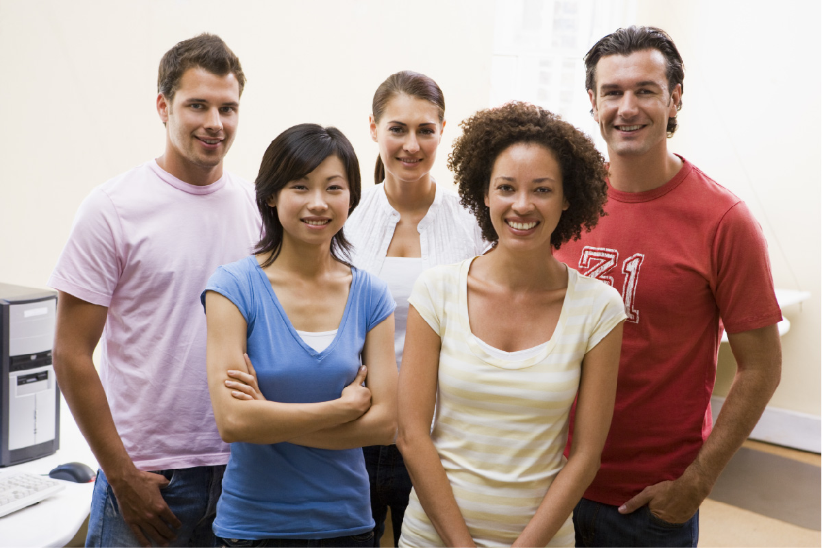 five people standing in a group smiling during a CMHA Kelowna activity